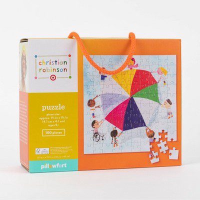 Jigsaw puzzle with children holding a parachute design
