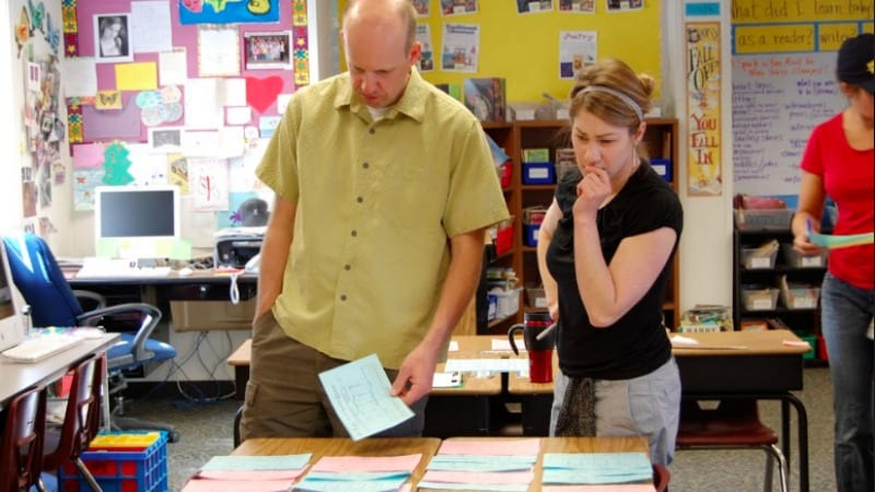 Teachers work in a team on creating balanced classrooms