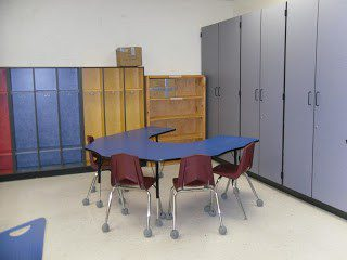 Classroom cabinets and chairs before photo