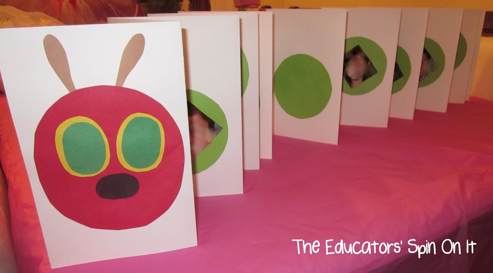 A caterpillar craft made from ten sheets of card stock, one for the head and 9 for the body