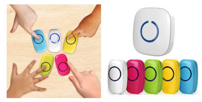 Four students using colorful classroom doorbell remotes to play a game