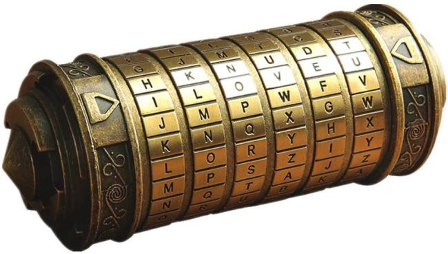 Old gold codex cylinder with letters