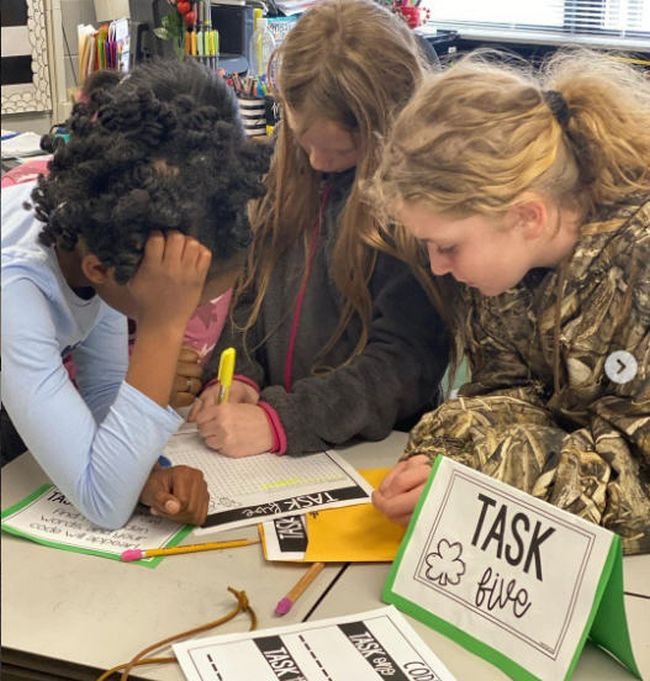 Students solving a task in a classroom escape room