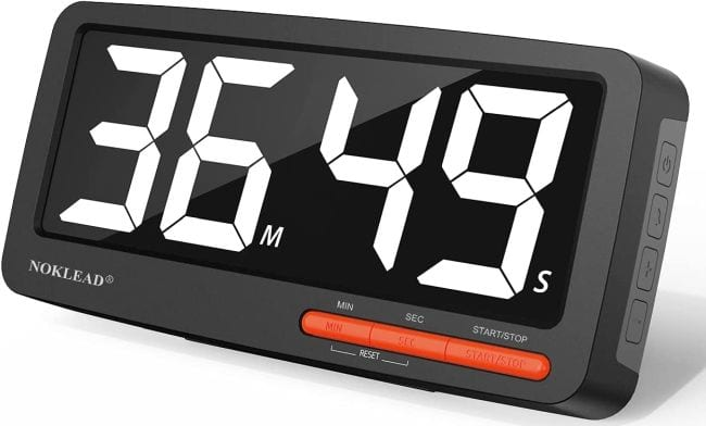 Large digital timer with black screen and white numbers reading 36:49