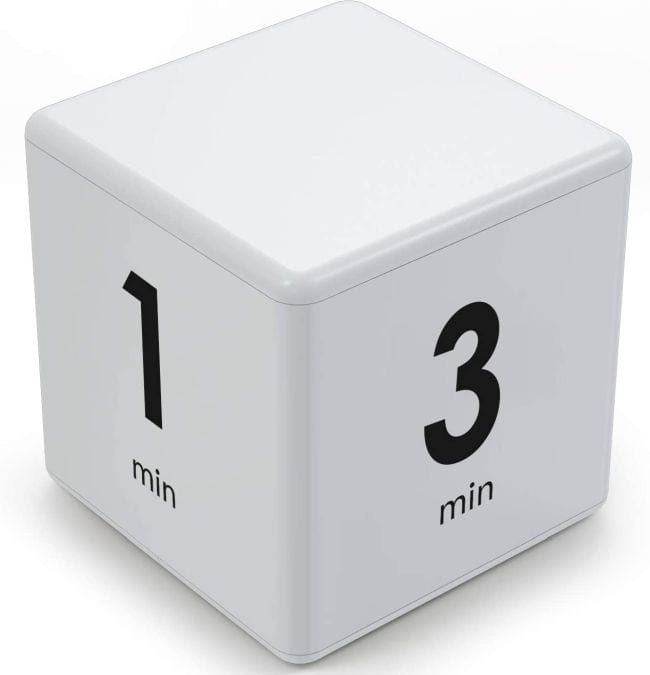 White cube timer with 1 min and 3 min sides showing