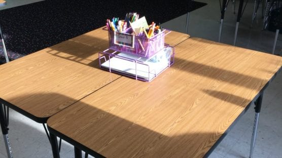 What are the pros and cons of student tables instead of desks?