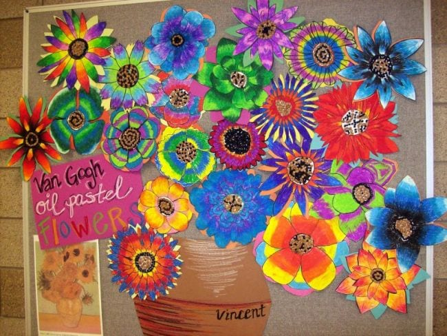 Van Gogh style flowers filling a large paper vase on a bulletin board (Collaborative Art)