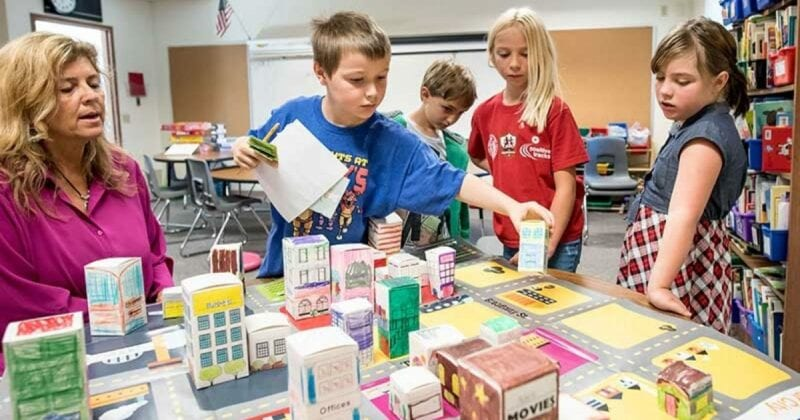 Children building on tabletop in creator space