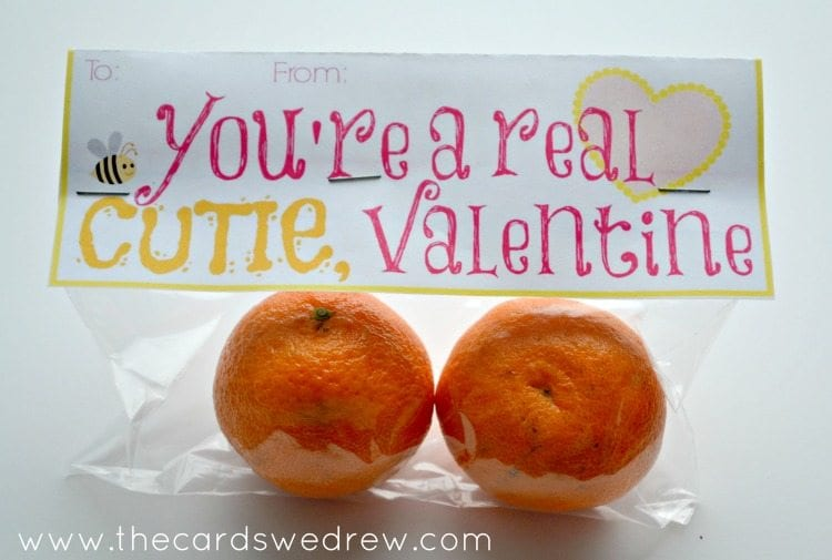 """Cellophane bag containing two clementines and a card that says, """"You're a real cutie, valentine"""""""