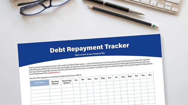debt repayment tracker worksheet on gray desk with pencils and eye glasses