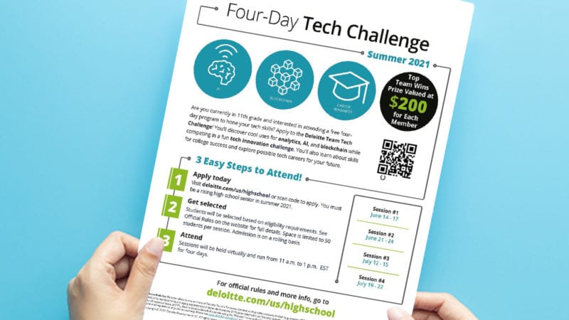 A close-up of a teacher looking over the four-day tech challenge printable.