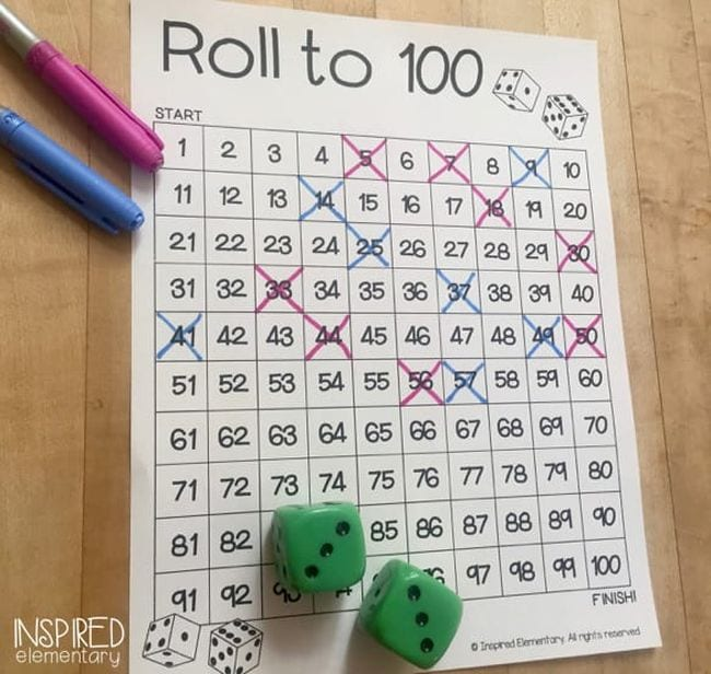 Roll to 100 hundreds chart with markers and two green dice