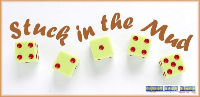 Five yellow dice with red spots; text reads Stuck in the Mud