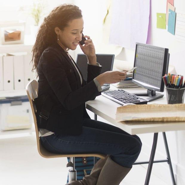 teacher sitting at a laptop