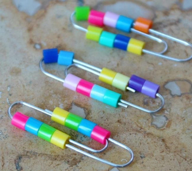 Colorful pony beads strung onto paperclips