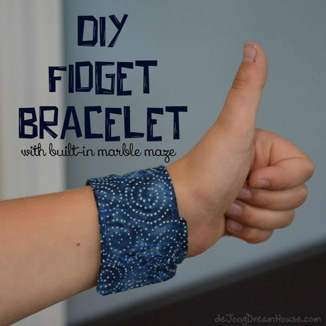 Child wearing a fabric DIY Fidget Bracelet with a hidden marble maze