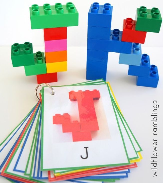 The letters J and K built from LEGO bricks, with a stack of cards (Dollar Store Hacks)