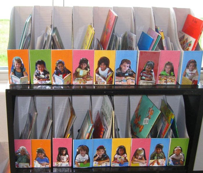 Cardboard magazine holders with children's photos on the front