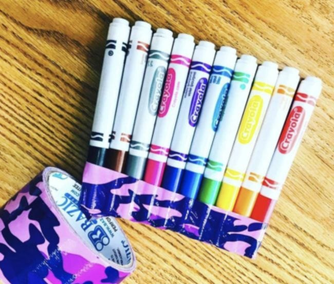 Crayola markers with their lids duct taped together
