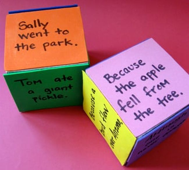Dry erase dice with various sentences written on each side
