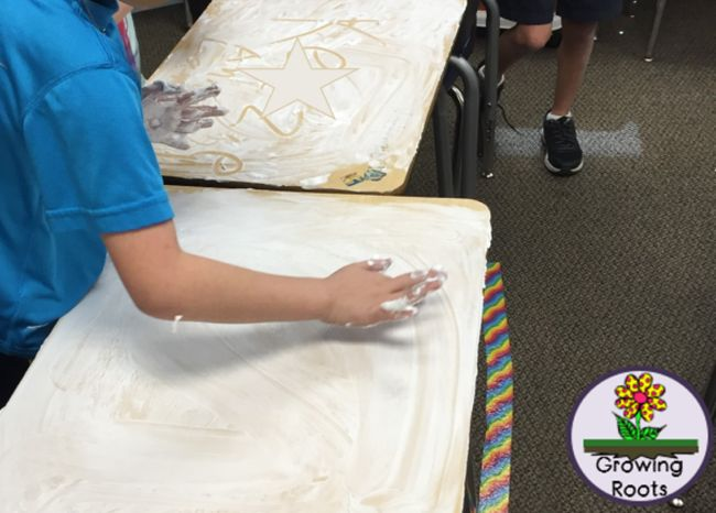 Students using shaving cream to clean their desks (Dollar Store Hacks)