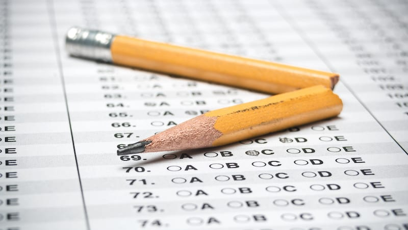 Standardized test with broken pencil (College Board drops SAT essay and subject tests)