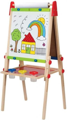 Easel with a house and a rainbow drawn on the roll of paper.