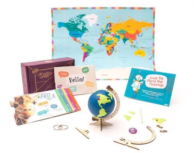 Array of geography learning items including a small globe from KiwiCo Atlas Crate