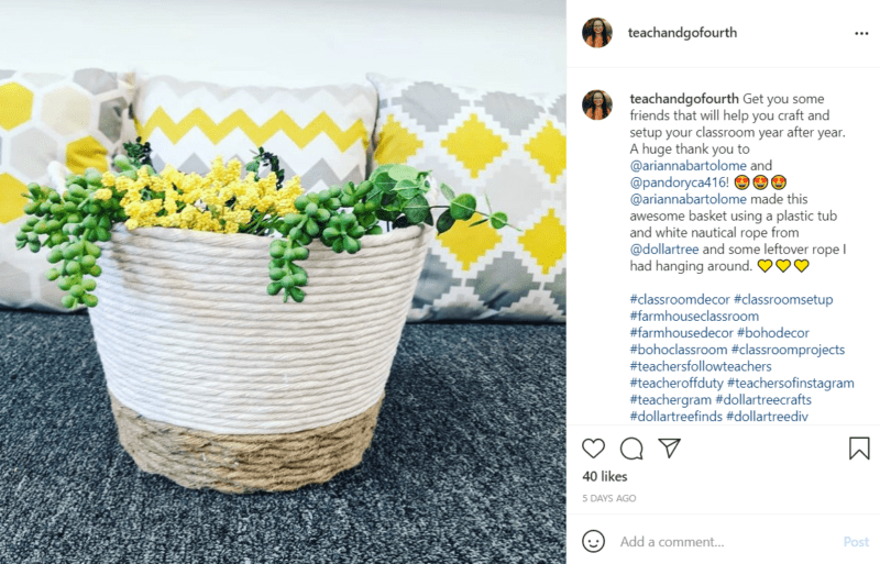 Green and yellow plants fill a small planter decorated with rope with white, grey, and yellow pillows in the background.