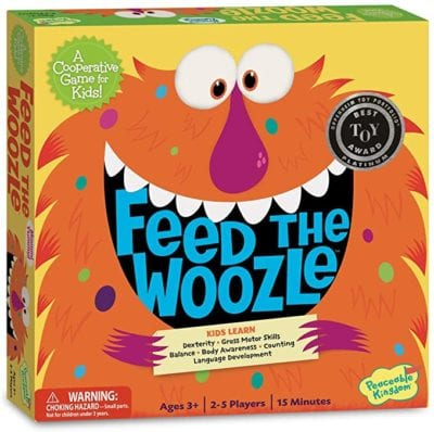 Box for Feed the Woozle cooperative preschool game showing an orange monster with google eyes and a large mouth with teeth