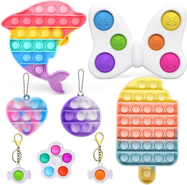 Bubble pop fidget toys in rainbow colors and shapes like a dolphin and ice cream cone (Fidget Toys)