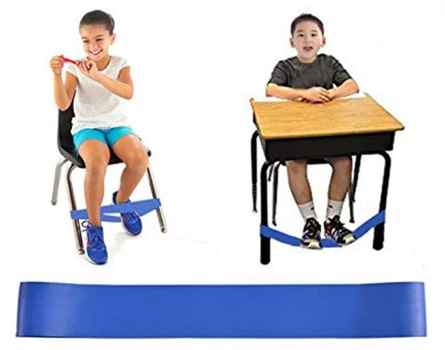 Students using fidget bands attached to their chair and desk legs