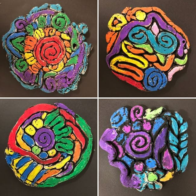 Clay art pieces sculpted from coils in bright colors (Fifth Grade Art)
