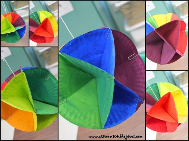 Collage of paper plates colored, folded, and glued to make 3D balls (Fifth Grade Art Projects)