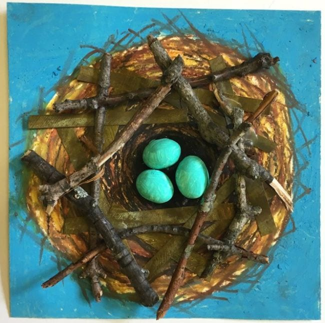Bird nest painted on paper, accented with twigs and clay eggs (Fifth Grade Art)