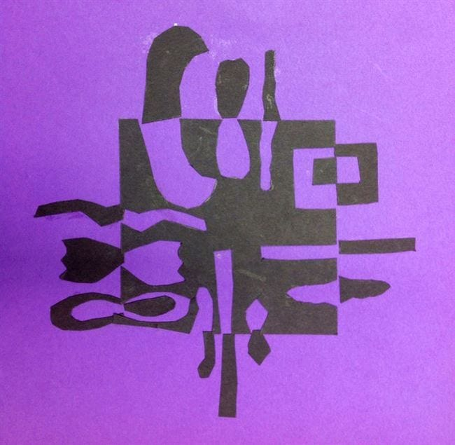 Abstract black shapes on purple paper