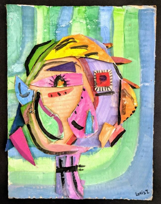 Picasso-style portrait of a girl made with pieces of colorful cardboard