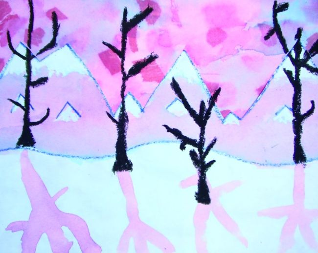 Pastel colored mountain range with bare trees, created with watercolor resist method (Fifth Grade Art)