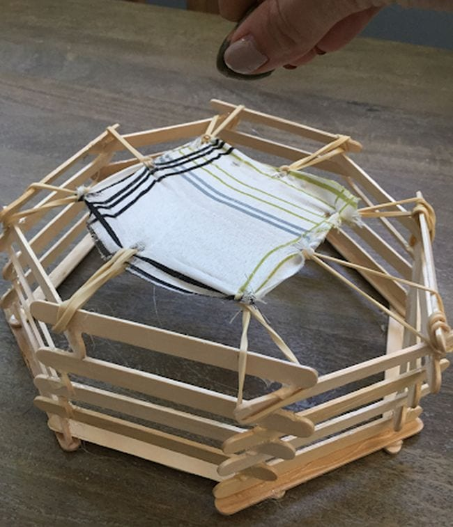 Miniature trampoline built from wood craft sticks, rubber bands, and fabric (Fifth Grade Science)