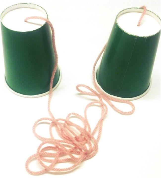 Two green paper cups connected at the bottoms by long pink string (First Grade Science Experiments)