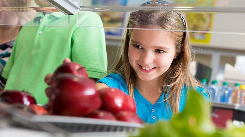 Girl Choosing Apple for School Lunch