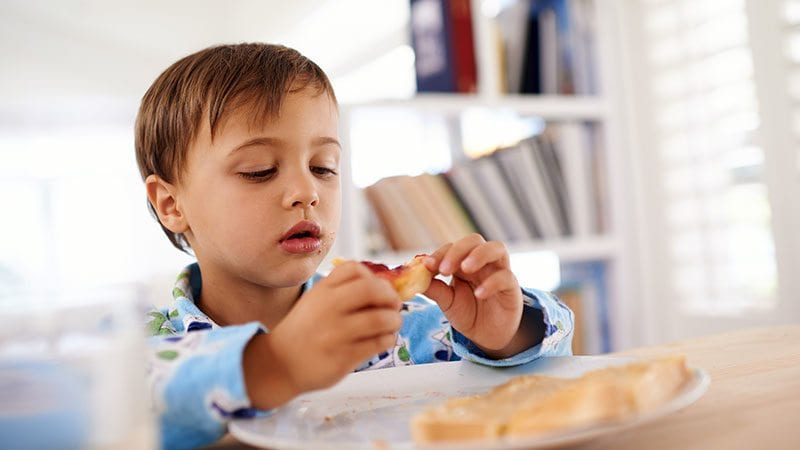 Child Eating Toast