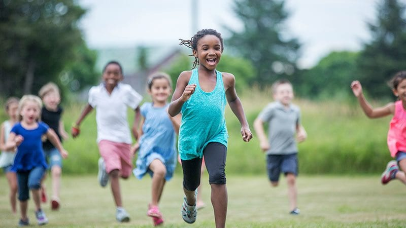 Elementary Students Running at Recess