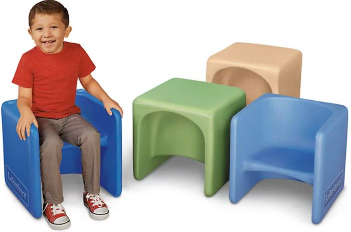 Toddler sitting on a 3-in-1 chair next to 3 others in various colors