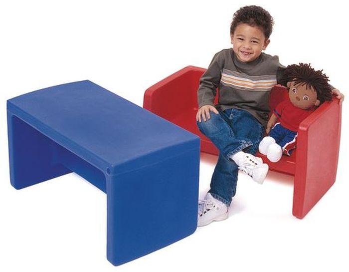 Student sitting on one Adapta-Bench® with a doll and using another as a table