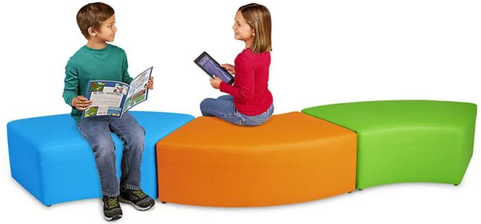 Students sitting on curved colorful cushions