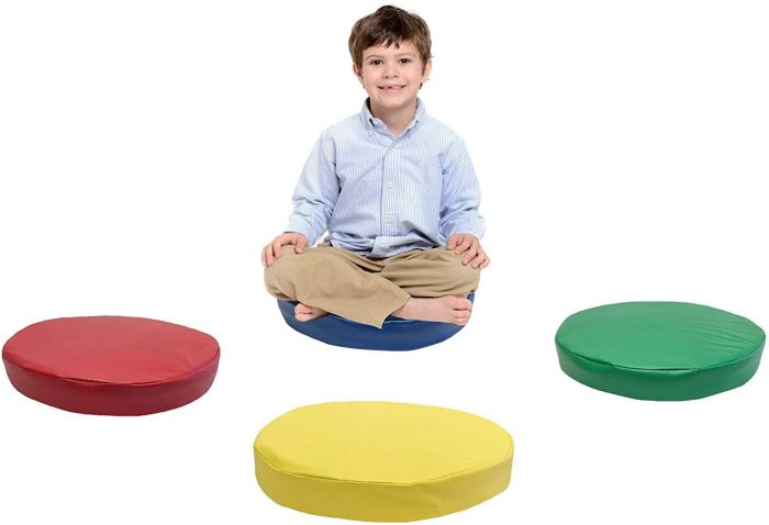 Child sitting on one of four colorful Kindermat round floor cushions (Flexible Seating Options)
