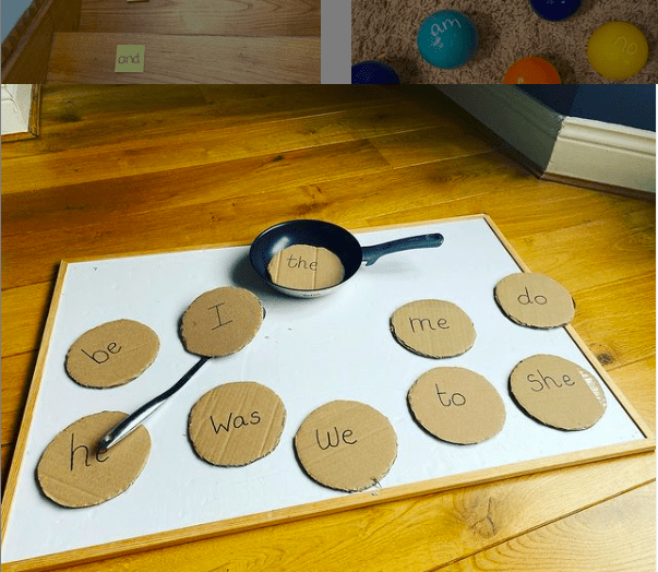 Sight words on cardboard circles that resemble pancakes with a small frying pan and spatula arranged on a white work surface