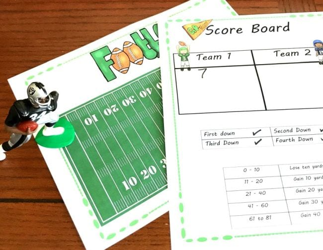 Printed paper football field with math worksheet describing the rules of the game