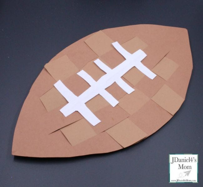 Football made of woven strips of brown construction paper